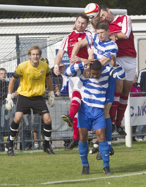 Didcot Town defender Richard Peirson (right), who decided to retire from football after a 20-year stint, following last weekend's FA Cup exit at home to Arlesey Town