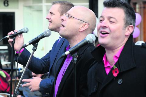 The Soldiers, left to right, Sgt Major Gary Chilton, Staff Sgt Richie Maddocks and L Cpl Ryan Idzi, sing in the Marketplace in Abingdon