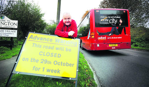 Chairman of Kennington Parish Council Peter Biggs at the road closure notice in the village. Picture: OX55205 Richard Cave