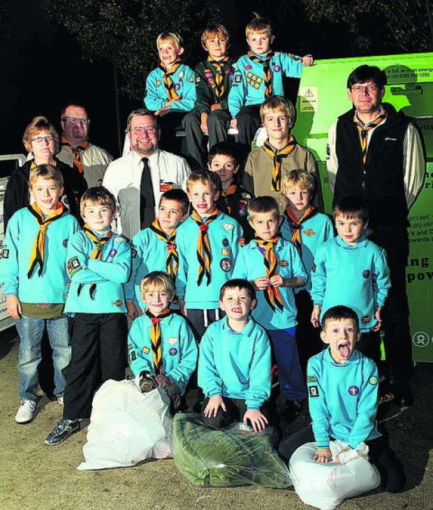 Some of the Beavers with, from left, assistant leader Claire Bellamy, Andrew Stokes, leader of Witney Scouts, Paul Johnson, deputy manager of Sainsbury's, young leader Riley Stokes, 14, and Lee Brown, leader of the Beavers