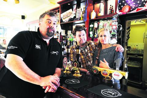 Andy Wilson, left, managing director of the White Horse Brewery, is pictured at The Royal Blenheim pub, in Oxford, with its managers Ian and Sara Liddle