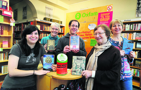 Volunteer staff from left to right, are Maura DiSalvo, Clare Balme, James Carruthers, Catherine Hilliard and Nora Novak with a selection of books