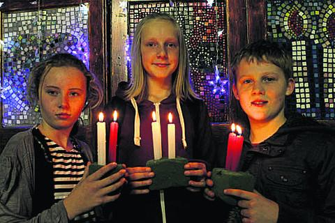 The Oxford Times: Pictured with candles at the event are, Ieft to right, Nicole Worrell, Billie-Jo Bourton and Elliot Cartwright