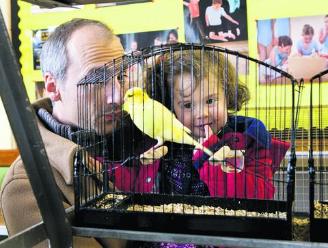 Boris and Ayla Salle look at a Border Canary