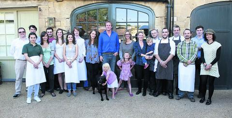 Sam and Georgie Pearman, centre, with the staff of the Chequers, in Churchill