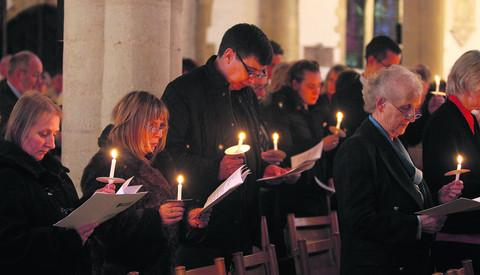 The Oxford Times: The congregation light candles at St Mary the Virgin Church in Thame
