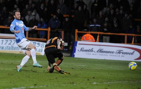The Oxford Times: Sean Rigg, pictured scoring against Barnet in the FA Cup recently, is back for the League Two fixture