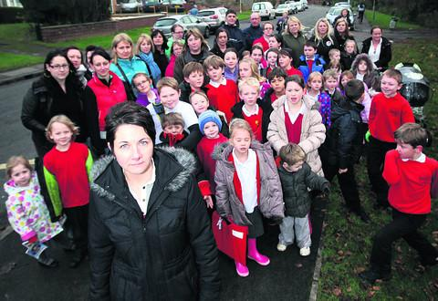 Karen Lewis, front, and fellow parents with their children outside Brookside Primary School, Bicester