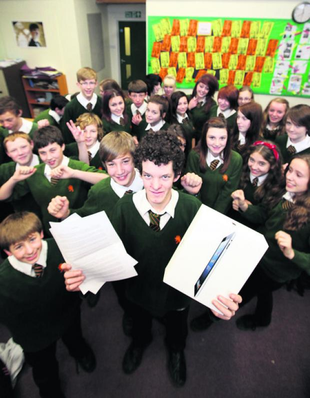 John Mason School Year Nine pupil Danny Kellard with his winning entry and iPad. Picture: OX56288 Damian Halliwell