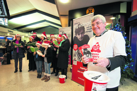 Pat Mulvihill, right, and carol singers at Oxford railway station