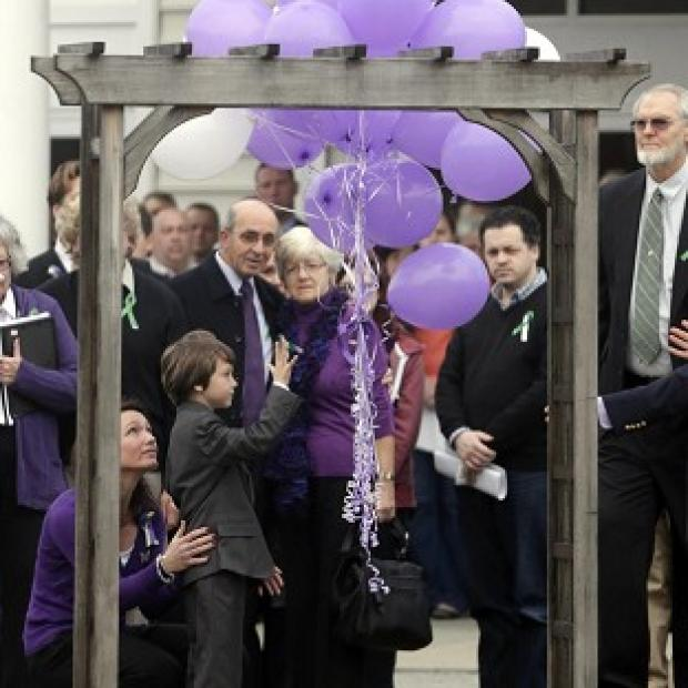 Nicole Hockley, left, and Jake release a bunch of balloons at the funeral service for his brother Dylan (AP/Seth Wenig)