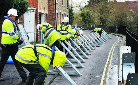 The Oxford Times: Flood barriers being installed at Osney Island in December 2012 during a previous flood warning period