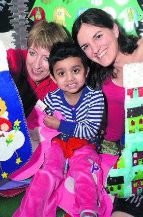 Three-year-old Hibba Butt from Milton Keynes, centre, with senior play specialist Christine Turner and Dr Sylvia Rueda