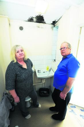 Susan and Bernard Zawilinski in the mouldy bathroom of their council home in Headington. Picture: OX56472 Jon Lewis