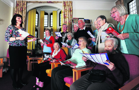 Naomi Taylor, right, and members of the St John's Care Home choir, who rely on a minibus to take them to performances. The home is  raising funds for a new one, because the old minibus, inset, is on its last legs