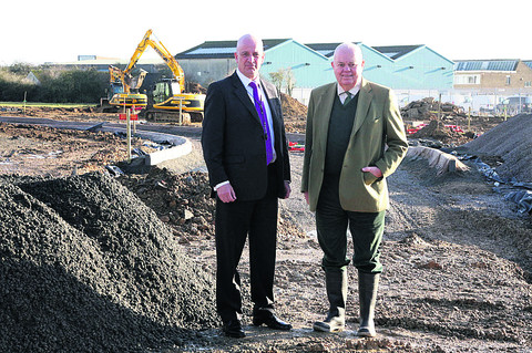 SUCCESSFUL: Paul Kourelias and chairman John Bond-Smith on the expanding site of West Oxfordshire Motor Auctions