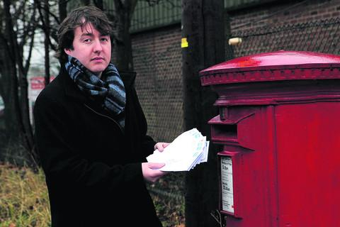Oxford Mail reporter Joe Nimmo posts some of the letters used in our test  Picture: OX56239 Ric Mellis