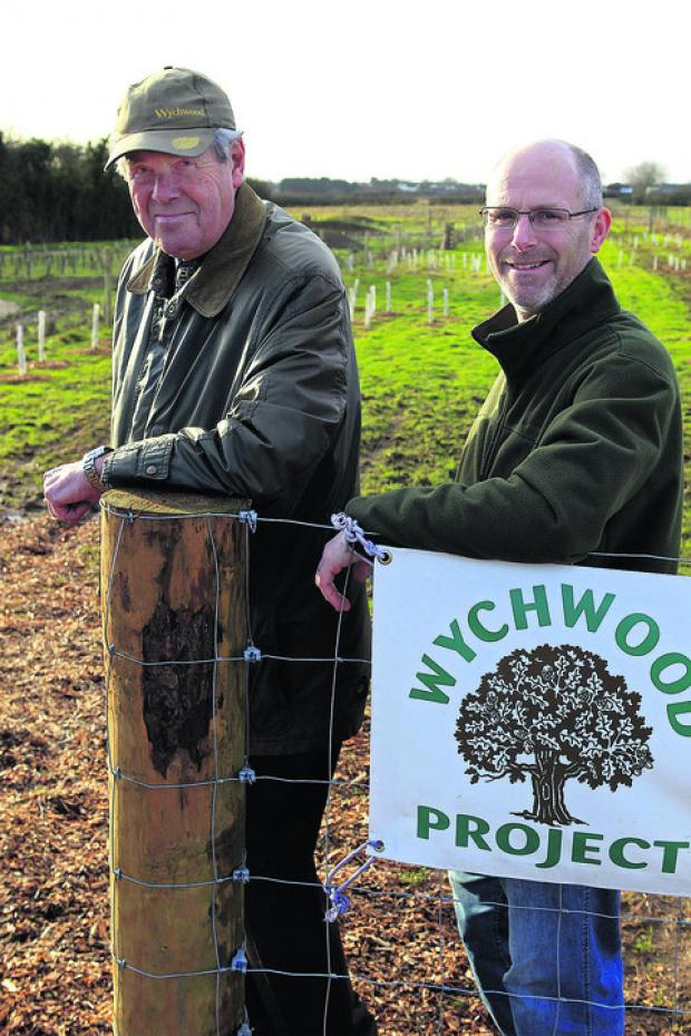Trustee Roy Noble, left, and Wychwood Project director Nick Mottram at the entrance to the 22-acre woodland on the edge of Witney