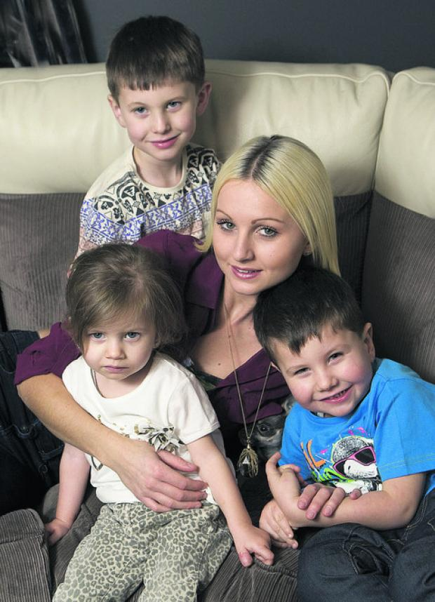 Stella Moore, who got through to Top Model UK finals, with children Reggie, back, Tilly and Reuben