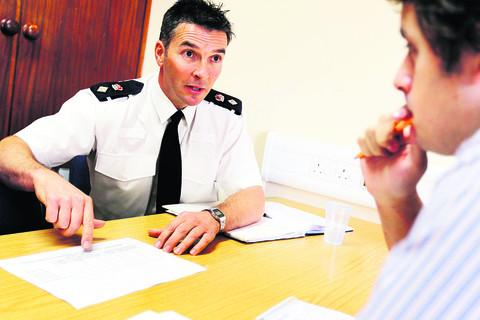 Chief Supt Alan Baldwin discusses the police response times with Oxford Mail crime reporter Ben Wilkinson. Picture: Ed Nix
