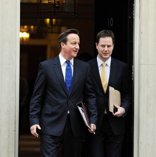 A dossier detailing progress on coalition pledges is set to be published by David Cameron and Nick Clegg