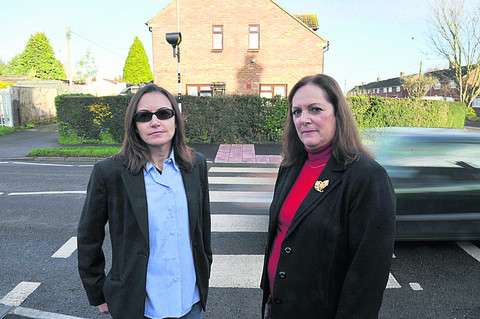 Ana Ramos, left, who campaigned for the crossing and Councillor Zoe Patrick by the crossing in Grove, which would not have been possible without the fund