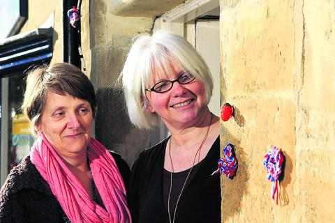 Claire Jarvis, left, and Lesley Wildman, who run the Fibreworks knitting shop in Chipping Norton, where a 'yarn bomber' has been attaching small knitted objects to lampposts and railings