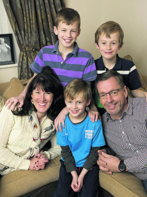 Cheryl and Paul Davis with sons Lucas, Miles and Edward