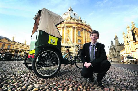 Tom Maxwell with one of his rickshaws in Radcliffe Square