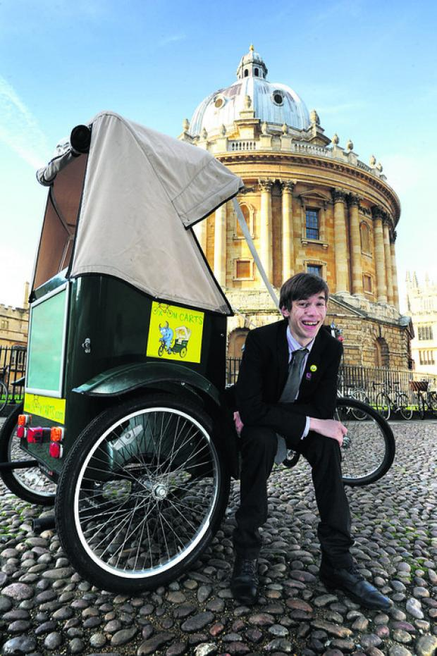 Tom Maxwell, 16, with one of his company's rickshaws