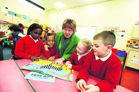 The Oxford Times: Headteacher Sue Mortimer in one of the new classrooms with pupils, from left, Victoria Akinbami, six, Jovarn Esterine, six,  Shaniqua Berry, six, and Eris Kola, five
