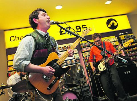 Young Knives playing at Oxford's HMV store in 2008. Henry, left, and Thomas Dartnall
