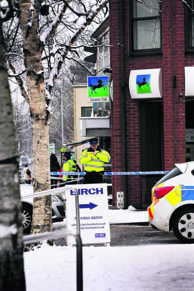 Police at the Lloyds TSB branch in London Road, Headington, after yesterday's armed robbery at the branch