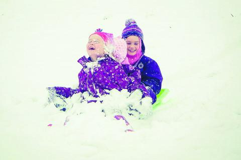Youngsters enjoy the snow on their sledge at Blenheim Palace in Woodstock in this picture sent in by Shellie Tungelund