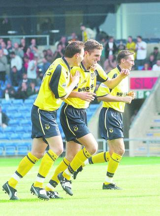 Dean Whitehead (left) celebrates a goal from fellow Oxford United youth team product Sam Ricketts back in 2001. Both players have gone on to play in the Barclays Premier League