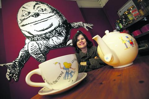 Story Museum co-director Tish Francis with a giant teacup and teapot