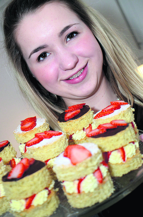 Charlotte pictured with one of her own recipes, mini strawberry Victoria sandwiches with cream