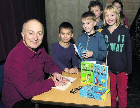 Tony Robinson with, from left, St Ebbe's School pupils Theo Delves, seven, Lucas Rydh-Smith, seven, and Erin Snape, eight. Picture: OX56742 Antony Moore