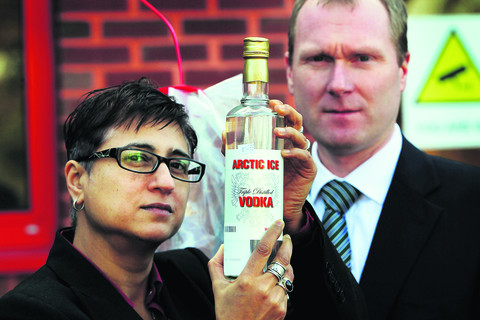 Trading Standards officers Anu Prashar and Richard Webb with the fake vodka