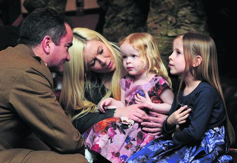 Cpl Andrew Roberts' widow Lindsey with their children, Jessica, seven, and Kayla, four, with Commanding Officer, Lt Col David Clouston