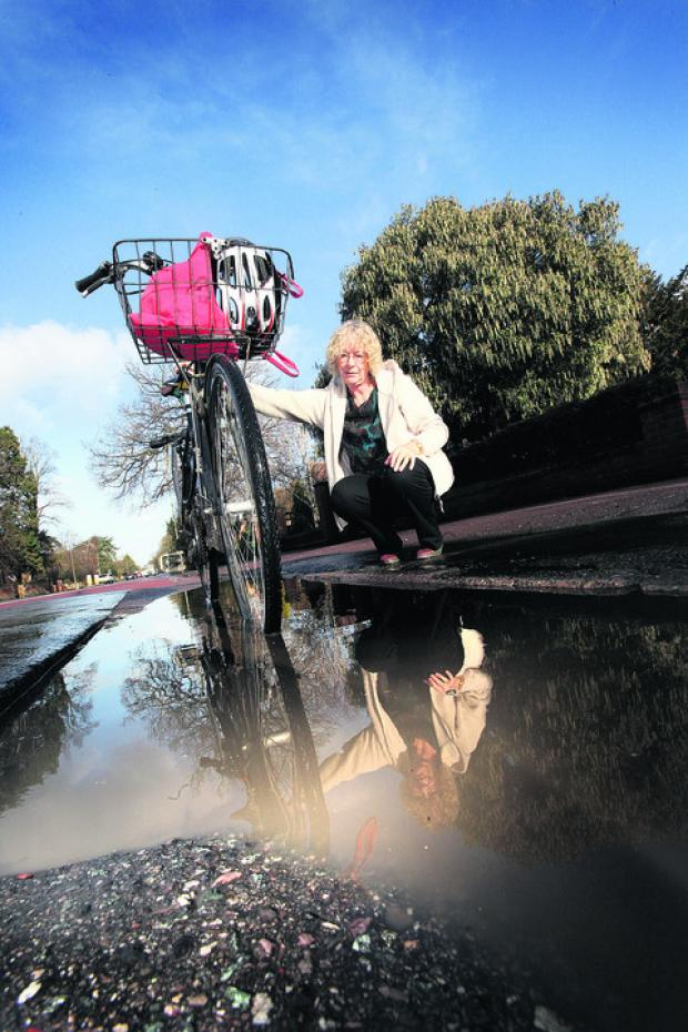 Susanna Pressel pictured by a flooded pothole in Banbury Road near Linton Road