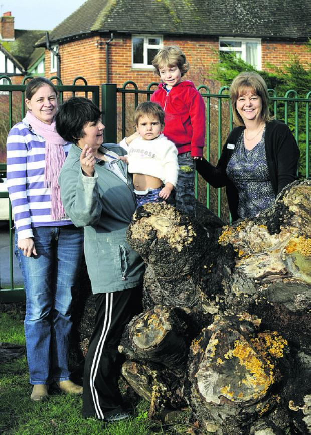The Oxford Times: Sarah Cooksley, back, with son Noah, three, and Rachel Cook, front, with daughter Rebecca Hedges, one, and centre manager Sandra Pearse, right. Picture: OX56983 David Fleming