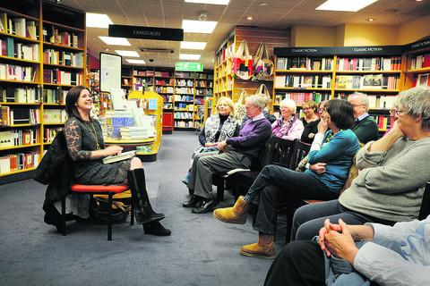The Oxford Times: Allan Ledger, 69, from Burford, pictured in the audience second right, with author Paula Byrne, far left