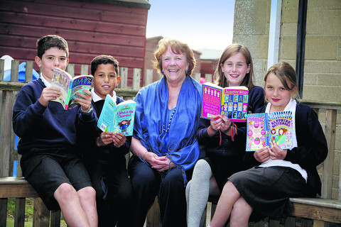 County council cabinet member for education Melinda Tilley with Buckland Primary School pupils, from left, James Coombs, 10, Joseph Langdon, nine, Abby Hallion-Gammon, 10, and Daisy Torrington, 10