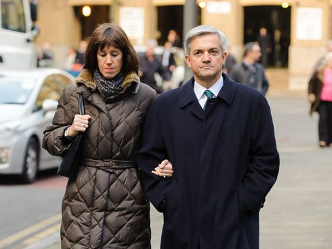 Chris Huhne and his partner Carina Trimingham arrive at Southwark Crown Court