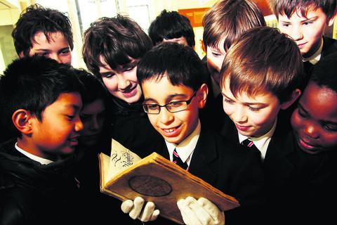 The Oxford Times: Yazan Odeh, 11, from Didcot, pictured with the book. Picture: OX57077 Ed Nix
