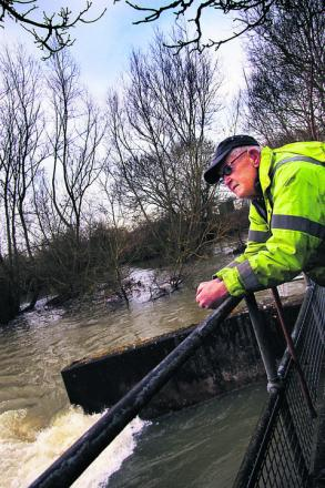 Roy Partridge surveys the flooded River Evenlode near his home at Cassington Mill