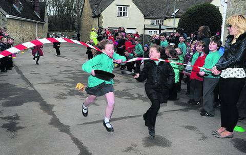 Ruby Gale and Grace Bradney cross the finishing line
