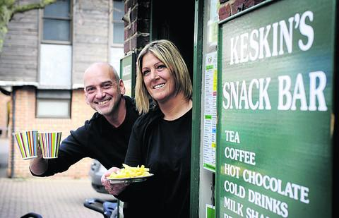 CHEERS: Hakan Keskin is leaving his cafe in the Market Place and handing over to Sally Newport    Picture: OX57287 David Fleming
