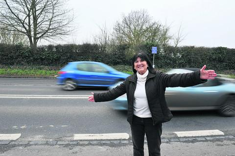 ELATION: A delighted Lorraine Lindsay-Gale celebrates at the site of the new crossing on the A4074 in Shillingford